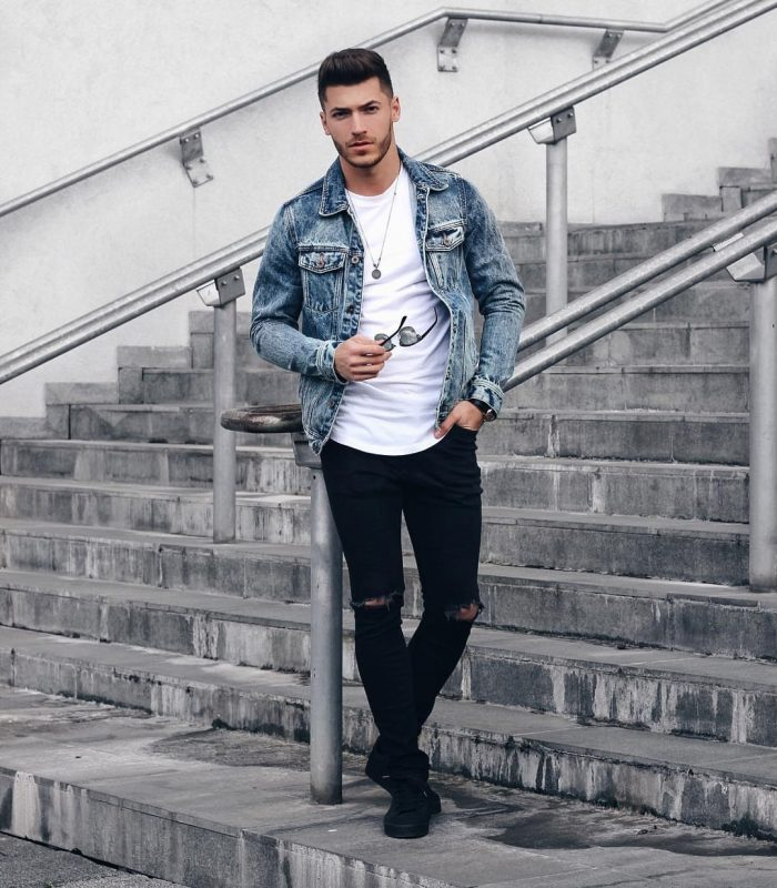 Blue denim jacket, white tee, black ripped jeans, black shoes