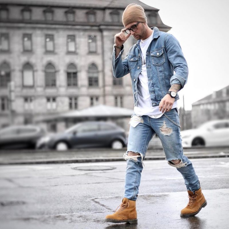 Brown beanie hat, blue denim jacket, white print tee, blue ripped jeans, brown boots
