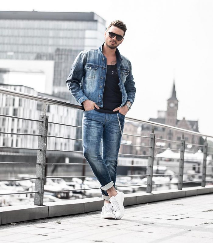 Black singlet, blue denim jacket, blue jeans, white sneaker