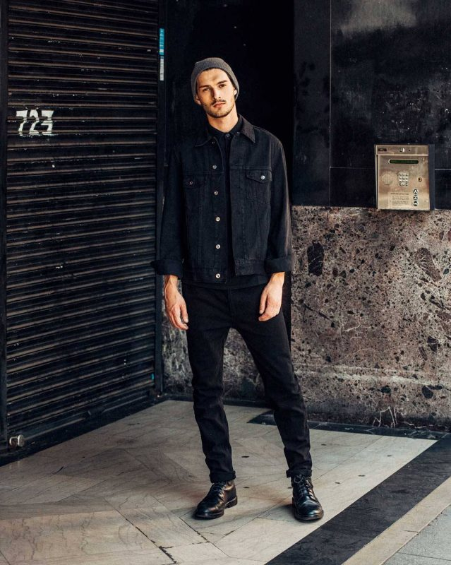 Black denim jacket, black tee, black jeans