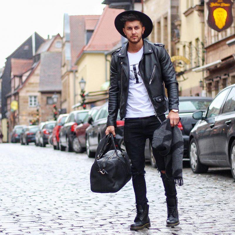 Leather biker jacket, tee, jeans, boots, fedora hat