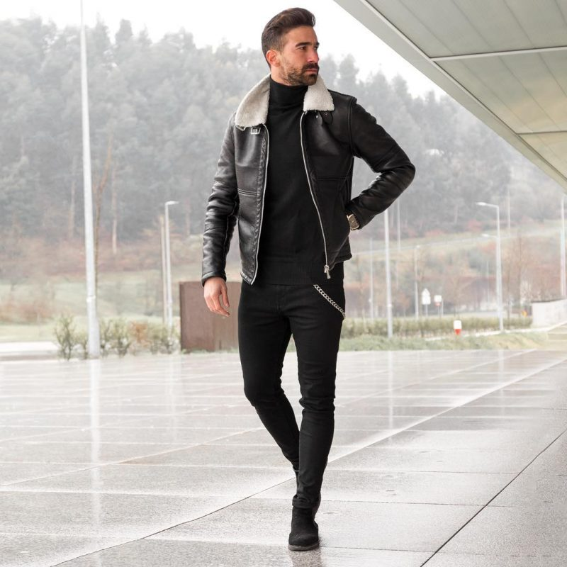 Leather flight jacket, sweater, black jeans and suede boots