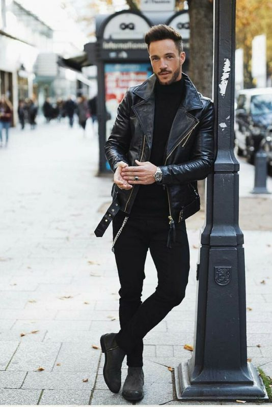 Leather biker jacket, black tee, black jeans, and suede boots
