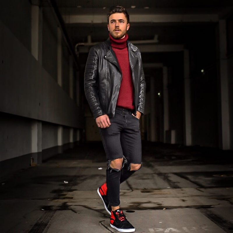 Leather biker jacket, red turtleneck sweater, ripped jeans, and black sneaker