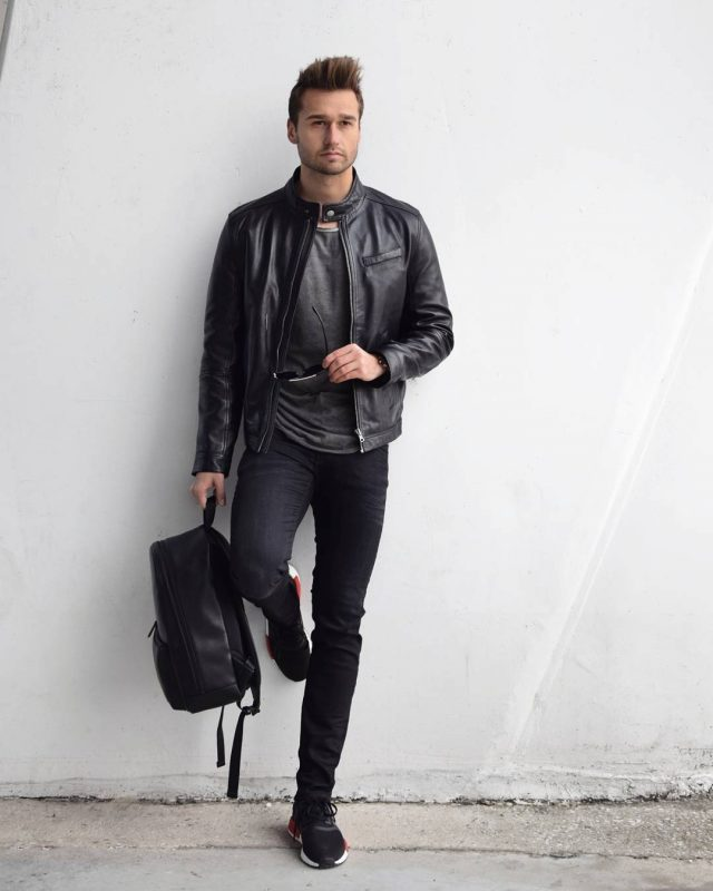 Leather racer jacket, gray tee, dark jeans, and sneaker