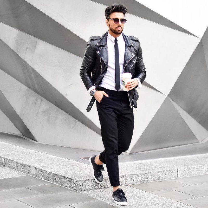 White shirt, skinny tie, leather biker jacket, black dress pants, and sneaker
