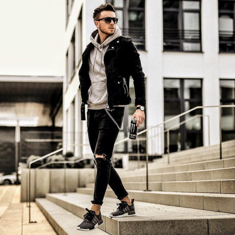 Gray hoodie sweatshirt, leather biker jacket, ripped jeans, and sport shoes