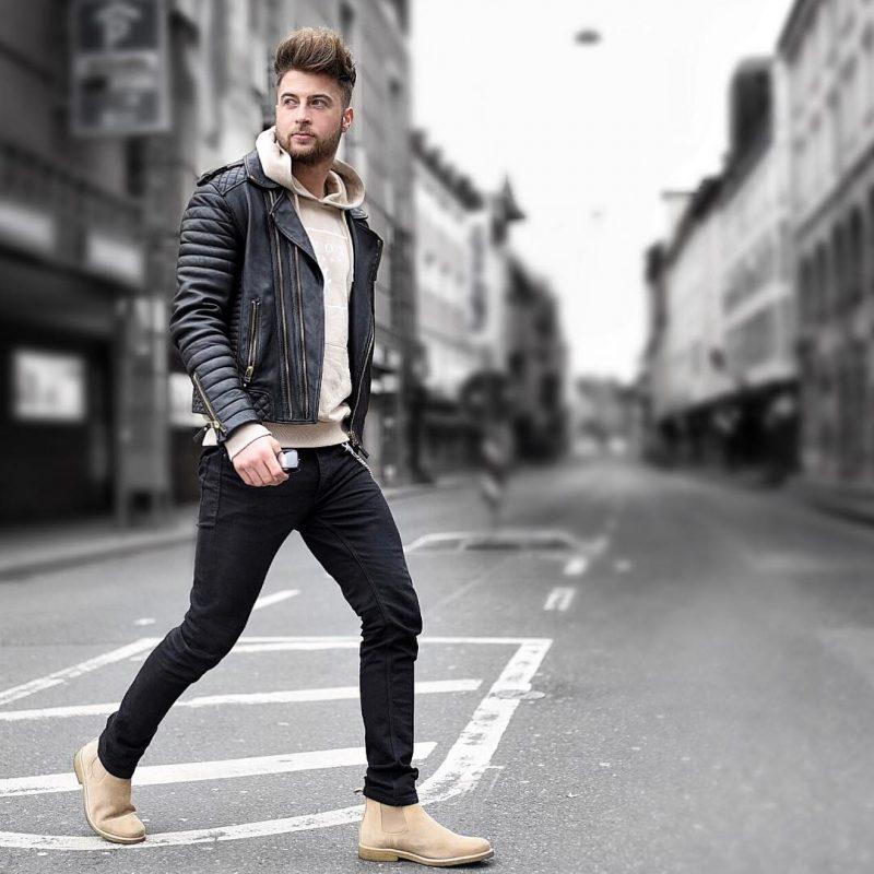 Beige hoodie sweatshirt, black leather jacket, black jeans, and Chelsea boots