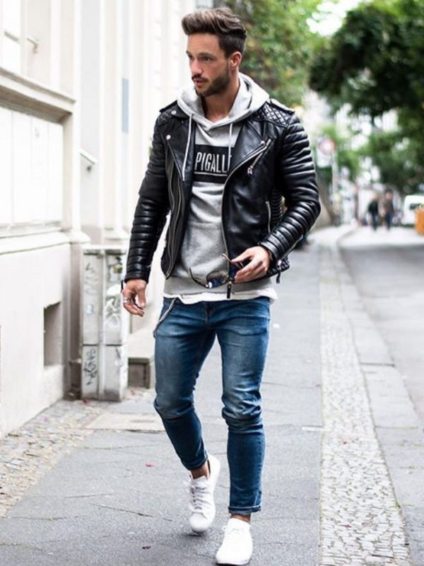Gray hoodie sweatshirt, leather biker jacket, blue jeans, and white sneaker