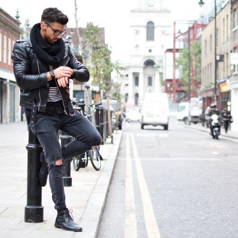 Leather biker jacket, print tee, scarf, black jeans, and leather boots