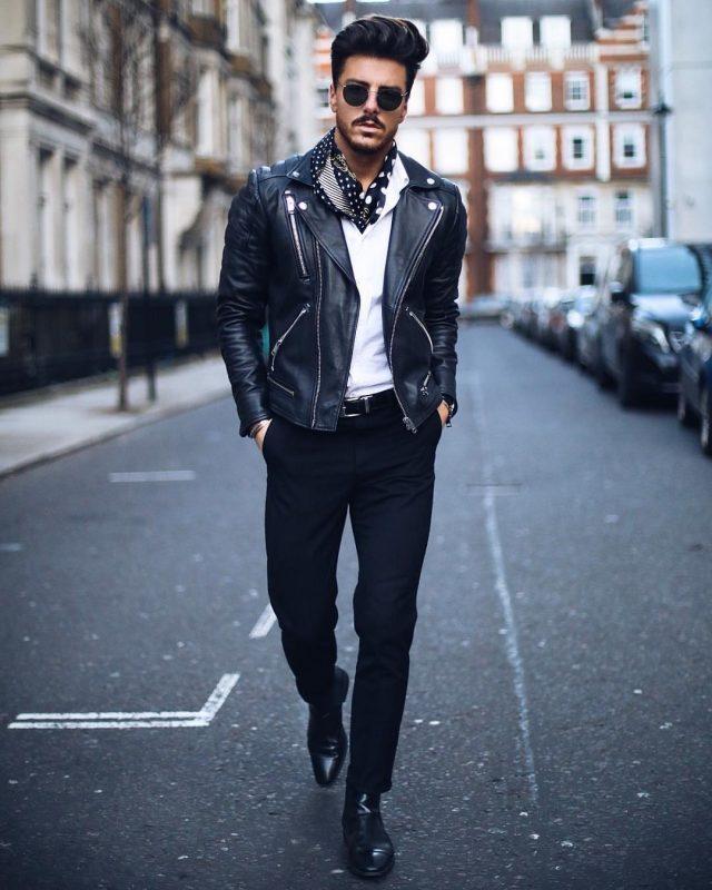 White polo shirt, leather biker jacket, dotted print cravat, black dress pants, leather belt, and dress boots