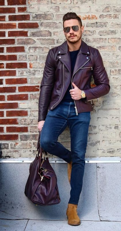 Maroon leather jacket, black tee, blue jeans, and suede boots