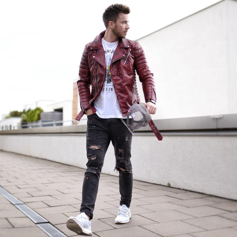 Burgundy leather biker jacket, white print tee, black ripped jeans, and white sneaker