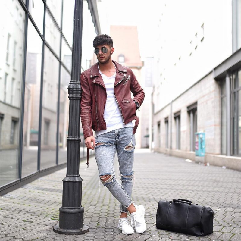 Burgundy leather biker jacket, white tee, ripped jeans, and white sneaker