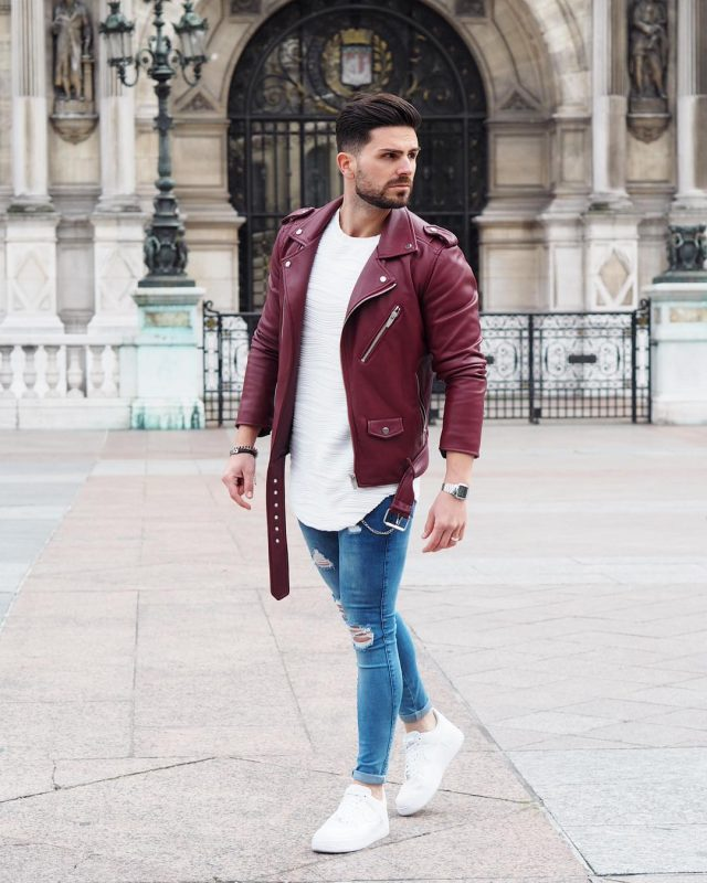 Red leather biker jacket, white tee, blue jeans, and white sneaker
