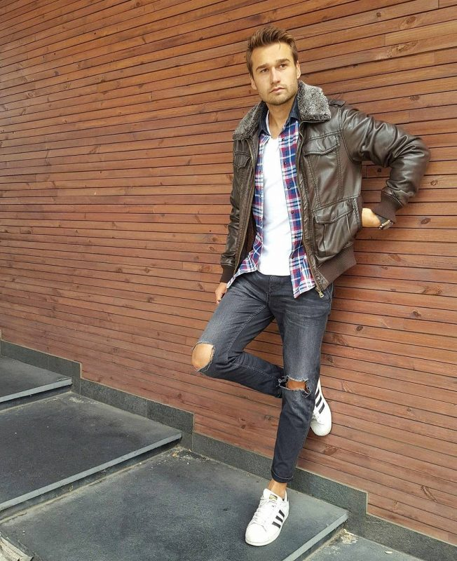 Dark brown leather field jacket, checked shirt, white tee, ripped jeans, and white sneaker