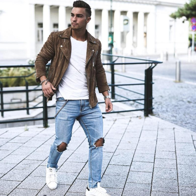 Brown suede leather jacket, white tee, blue ripped jeans, and white sneaker