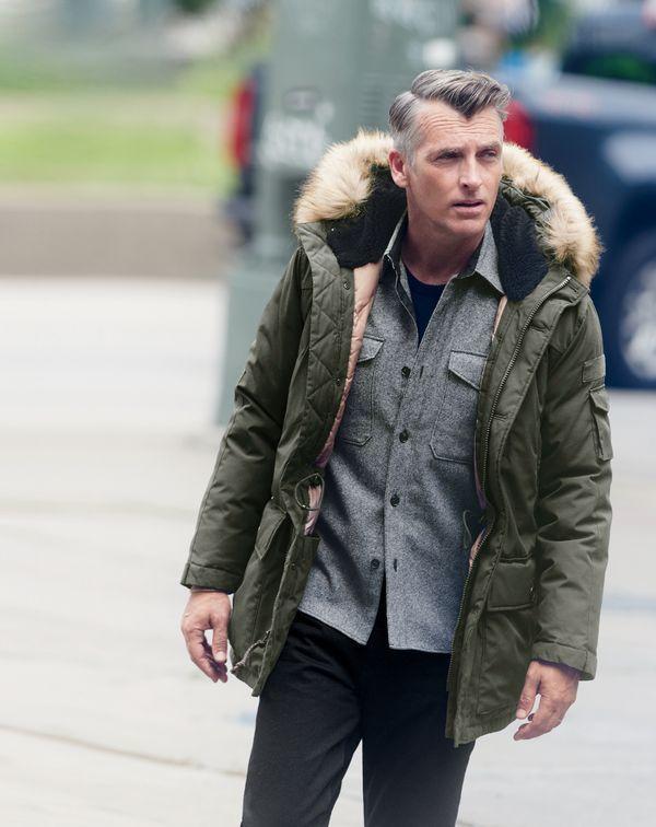 Parka jacket, black tee, overshirt, jeans