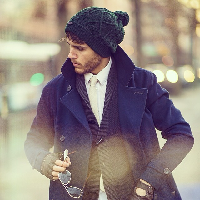 Green knitted bobble hat, blue peacoat, white shirt, tie, gray cardigan, leather glove 1