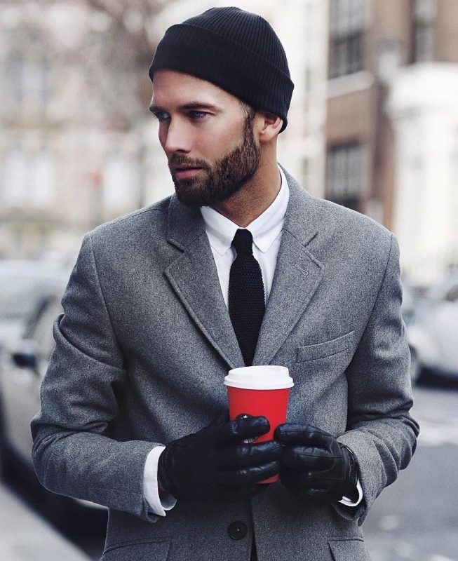 Black cuffed beanie hat, white shirt, black tie, gray wool suit, black leather gloves 1