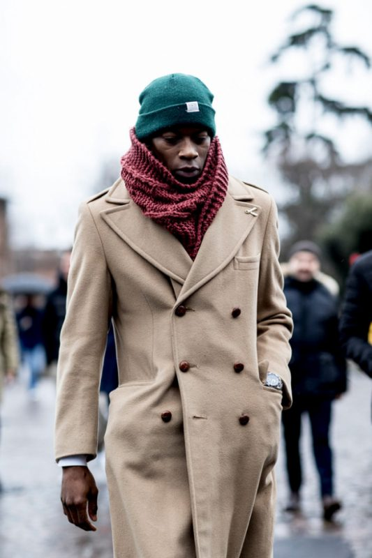 Green cuffed beanie hat, white shirt, brown overcoat, red scarf 1