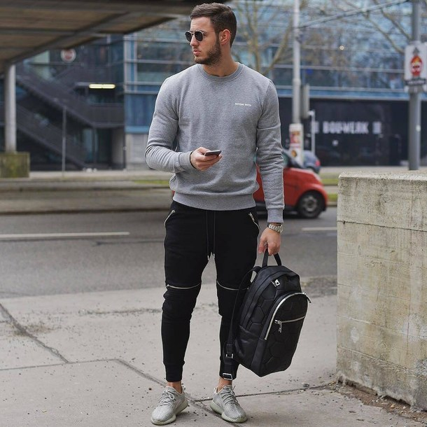 Gray sweater, black sport pants, training shoes, backpack 1