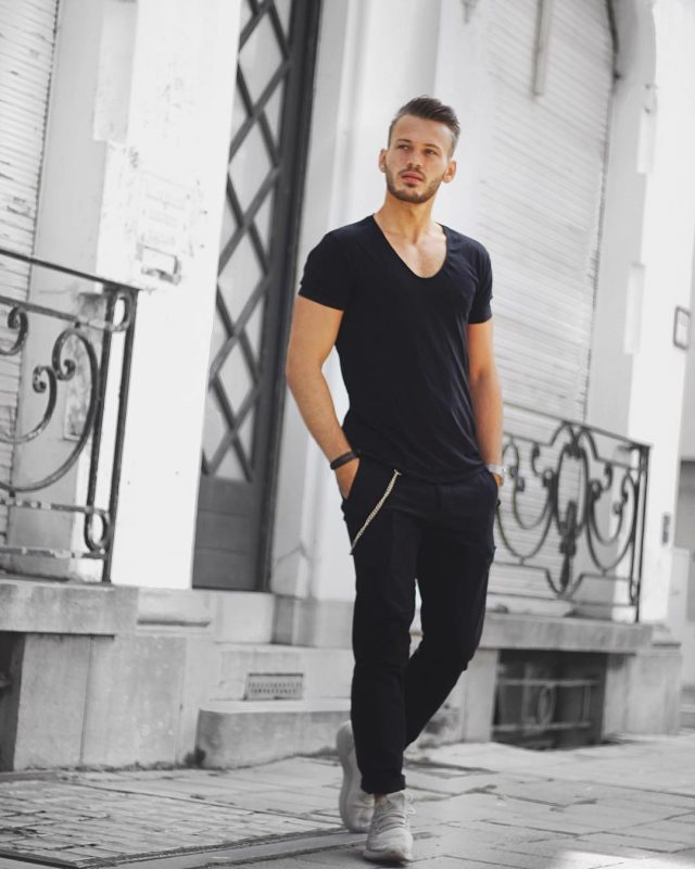 V-neck black tee, black trousers, training shoes 1