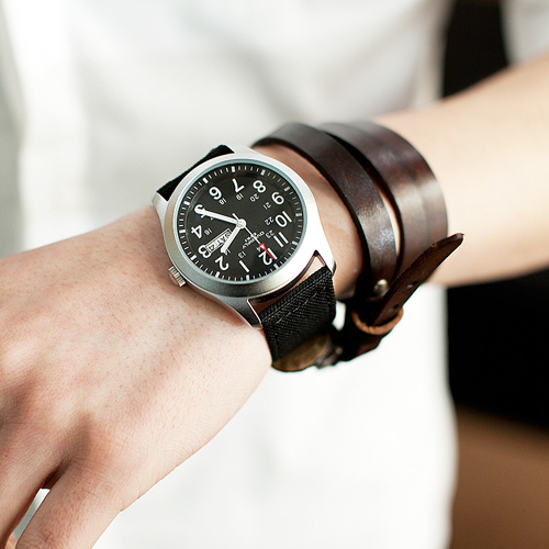 Man wears a watch and leather bracelet 1