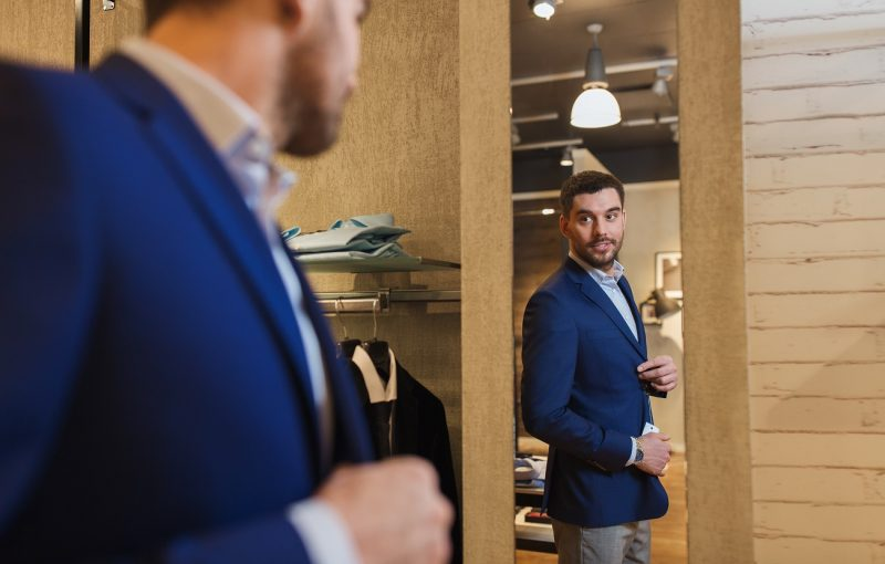 Man trying clothes with blue blazer and blue shirt 1