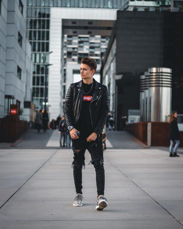 Black tee, black leather jacket, black ripped jeans, sneaker 1