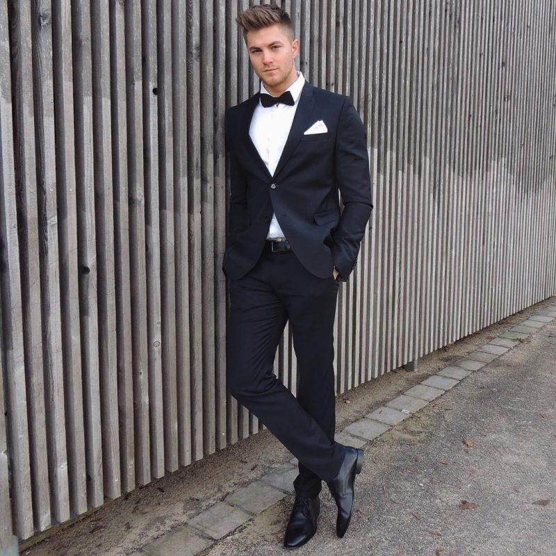 White shirt, black bow tie, black suit, leather dress shoes 1