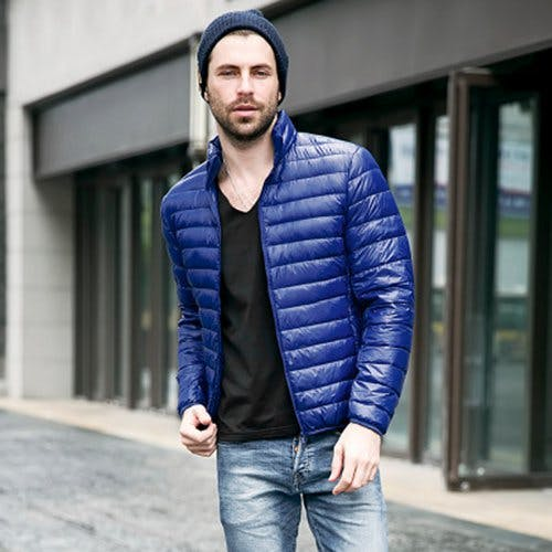 Blue puffer jacket, v-neck black tee, jeans, beanie hat 1
