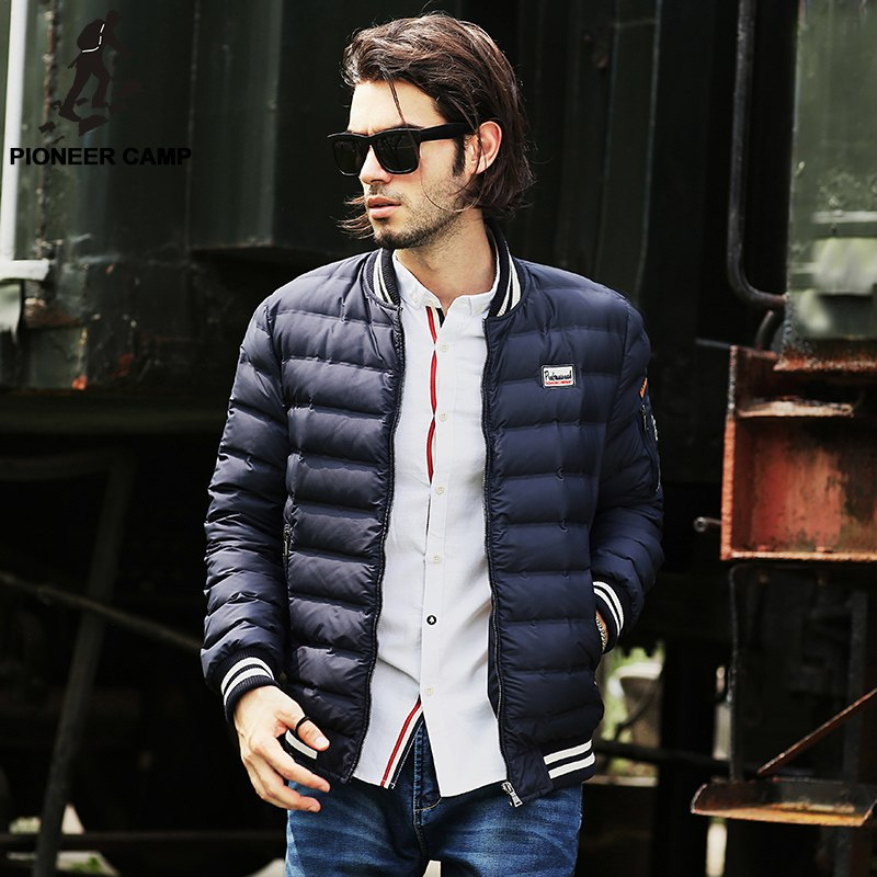 White shirt, blue puffer jacket, jeans 1