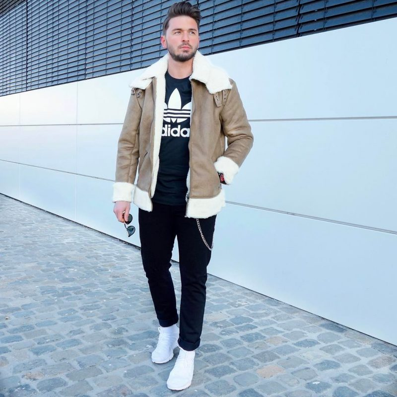 Tan shearling leather jacket, black t-shirt, black jeans, white sneaker 1