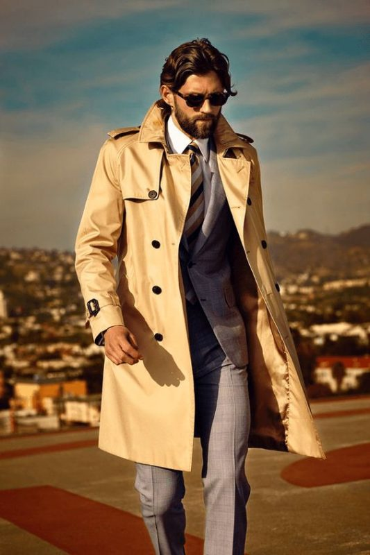 Beige trench coat, grey wool suit, white shirt, pinstripe tie, shades 1