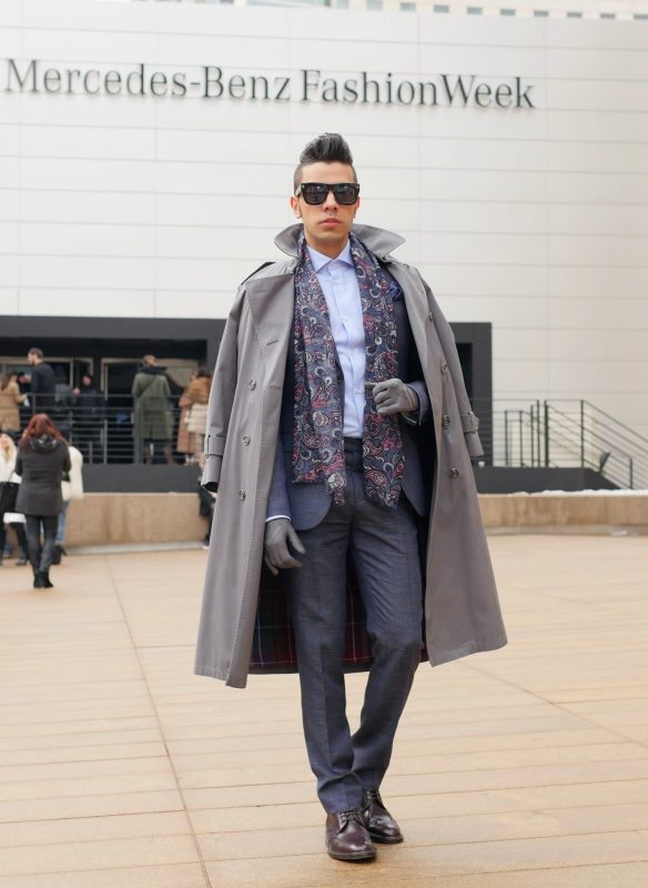Grey trench coat, wool suit, light blue shirt, patterned scarf, shades 1