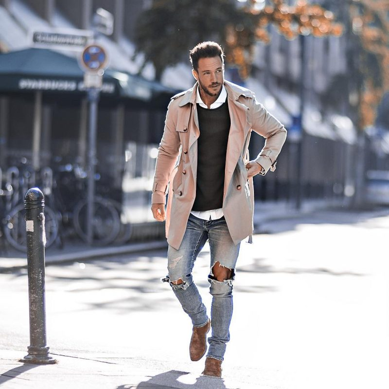 Beige trench coat, white shirt, black sweater, jeans, Chelsea boots 1