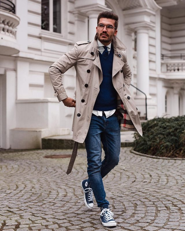 Tan trench coat, blue sweater, tie, jeans, white shirt, sneaker 1