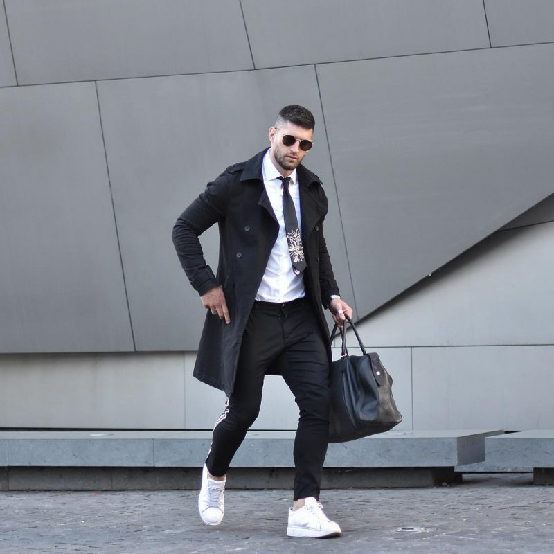 Black trench coat, white shirt, patterned tie, suit pants, white sneaker 1