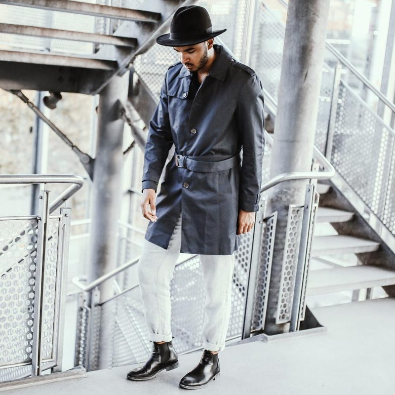 Black trench coat, white jeans, fedora hat, leather Chelsea boots 1