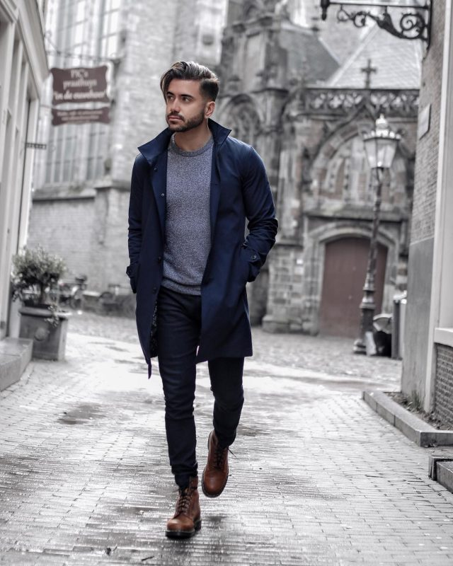 Navy trench coat, grey sweater, blue jeans, brown leather boots 1