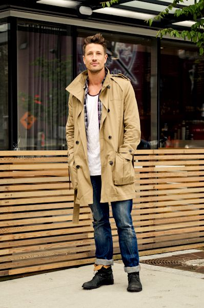 Tan trench coat, checked shirt, singlet, blue jeans, leather boots 1