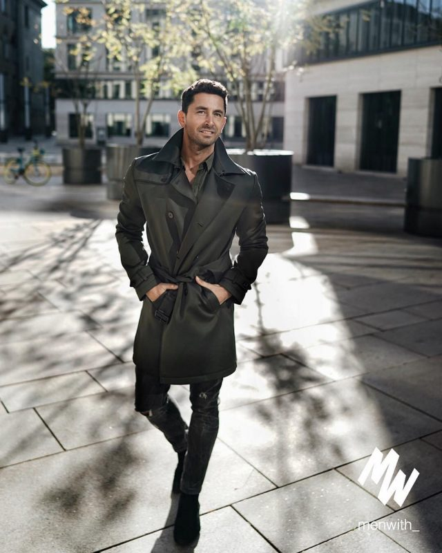 Black trench coat, olive green shirt, black jeans, suede boots 1