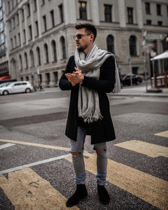 Gray scarf, black overcoat, light blue ripped jeans, suede boots 1