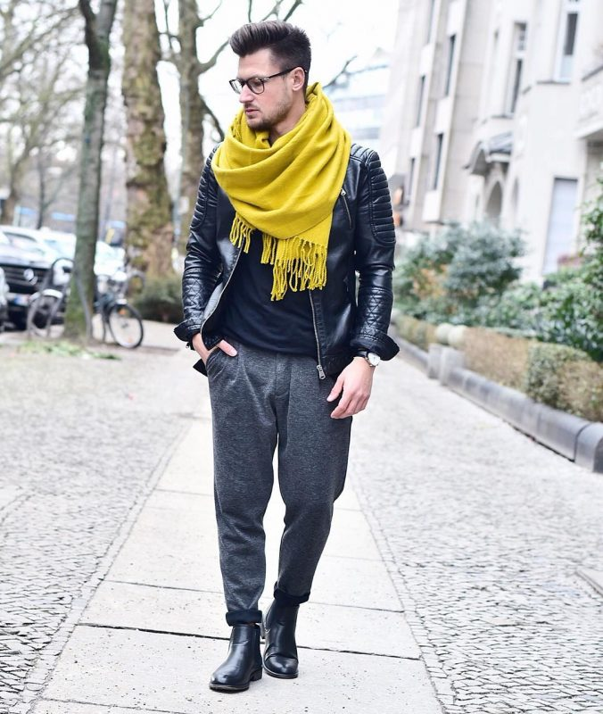 Yellow scarf, black t-shirt, leather jacket, sweatpants, boots 1