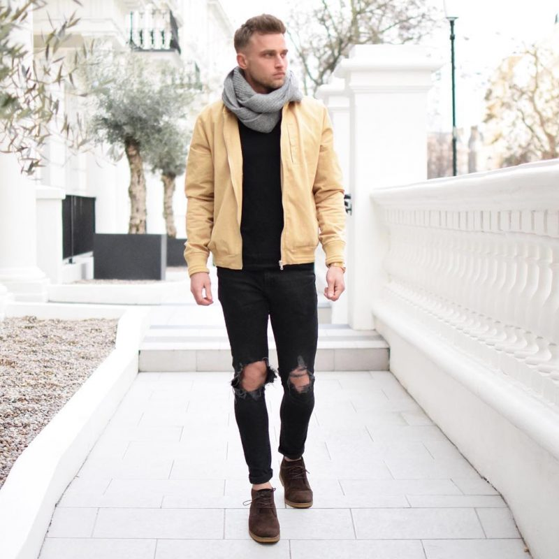 Gray scarf, bomber jacket, black t-shirt, ripped jeans, suede shoes 1