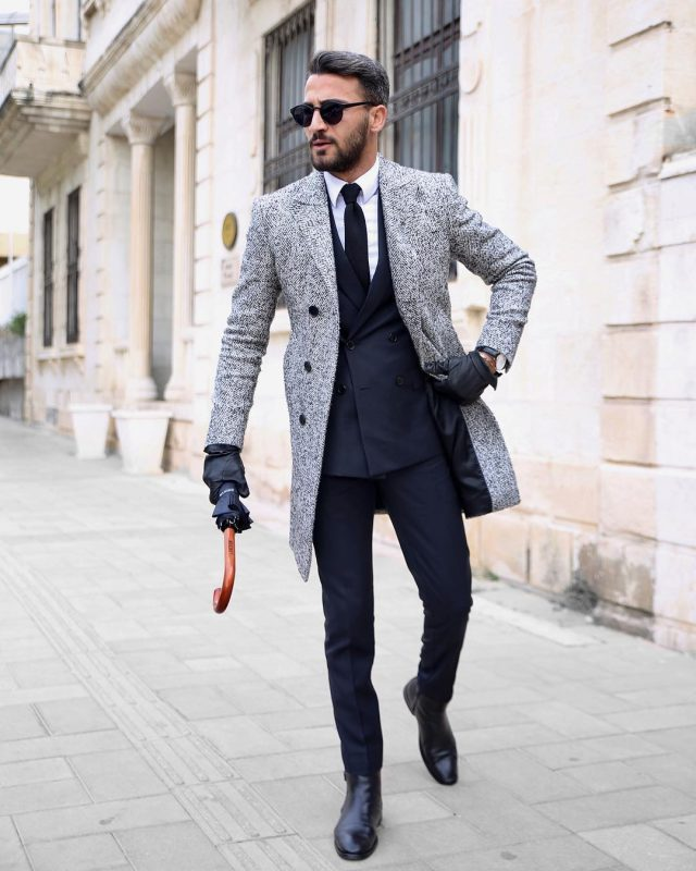 Grey wool overcoat, blue office suit, leather boots, leather gloves 1