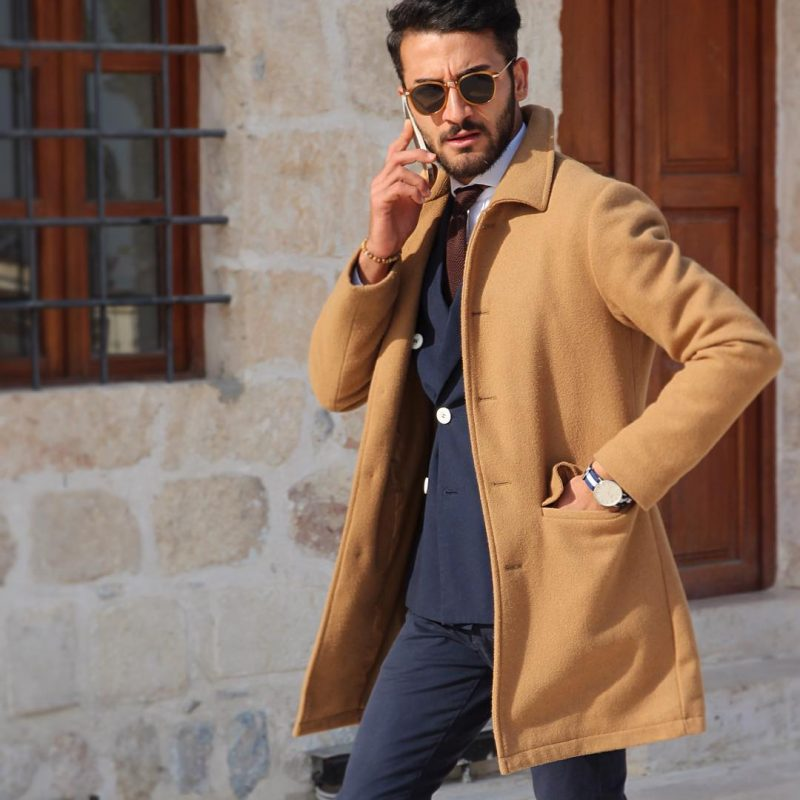 Camel wool overcoat, blue double-breasted suit, shades 1