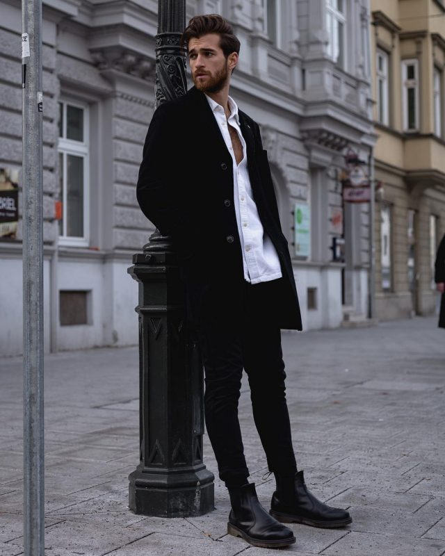 Black overcoat, white shirt, black jeans, black leather Chelsea boots 1
