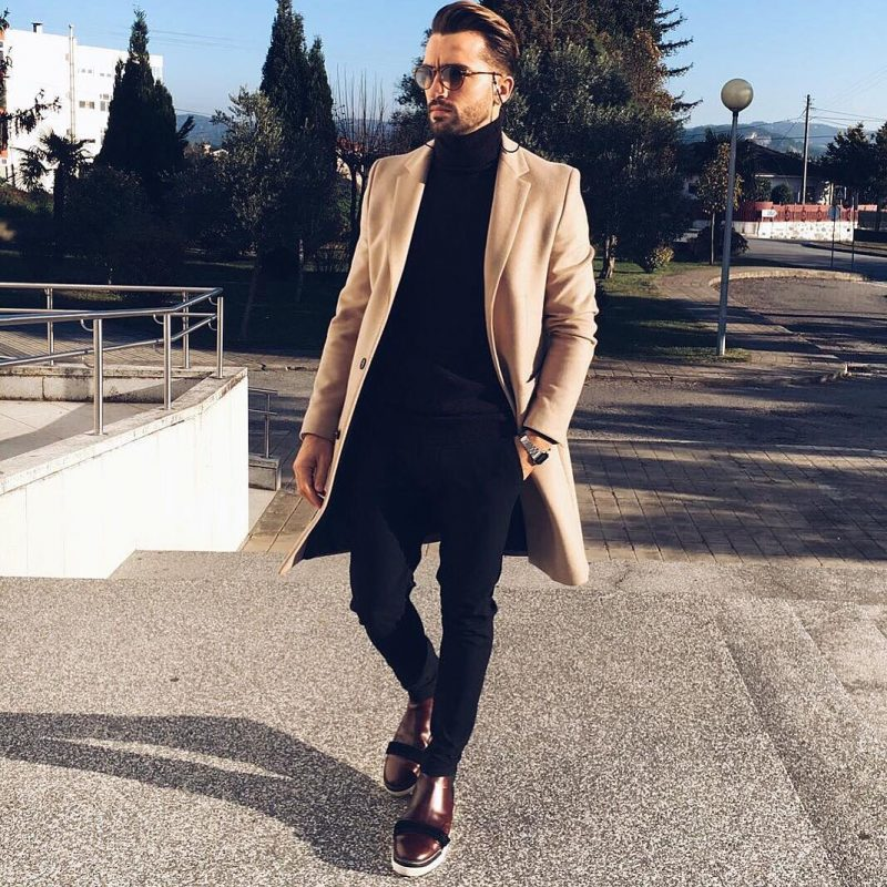 Camel overcoat, black sweater, brown leather boots 1